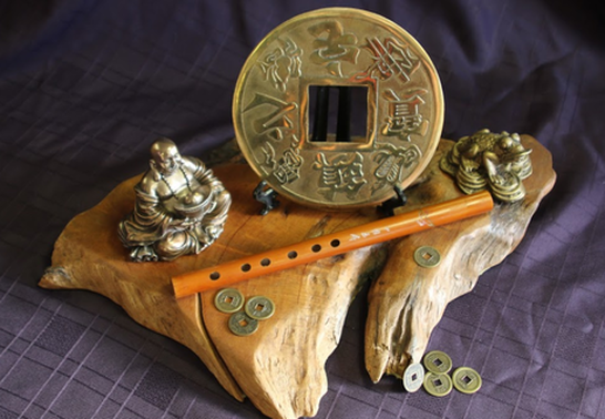Buddah, chinese coins, flute in the Center for Spiritual Awakening Mind Shop in Pacific Grove Ca